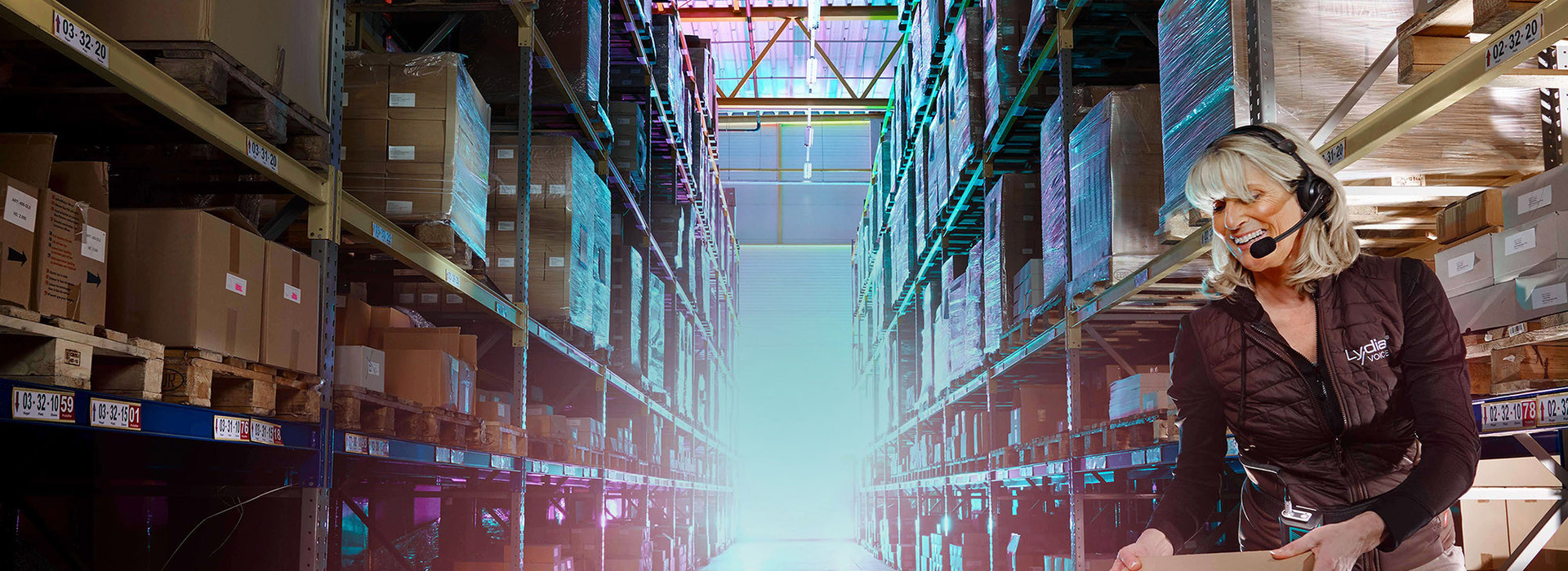 Woman is picking in the warehouse with the voice picking software Lydia Voice.